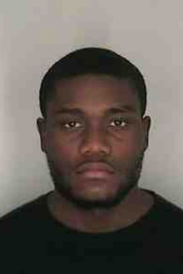 Olivier Famby of New Rochelle was charged in a string of armed robberies that occurred near train stations in early 2012.