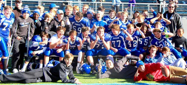 Darien 7th grade youth football players celebrate after the Wave and Blue were named co-champions of the Fairfield County Football League.