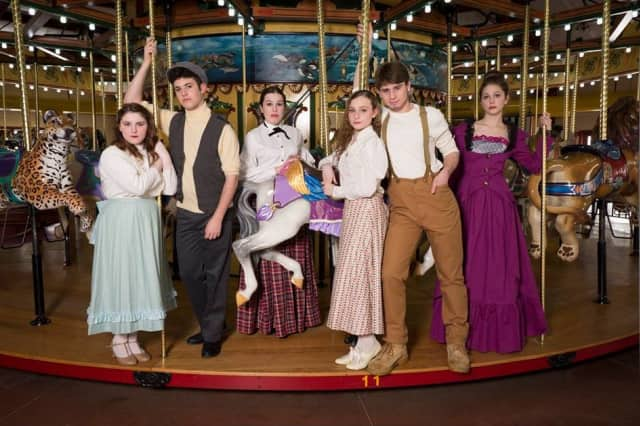 Weston High School students Rebecca Borowik (as Carrie Pipperidge), Ross Cohen (Enoch Snow), Kaitlin Brozek (Nettie Fowler), Janna Sturgis (Julie Jordan), Jack Seigenthaler (Billy Bigelow) and Sarah Metchick (Mrs. Mullin) star in Carousel.