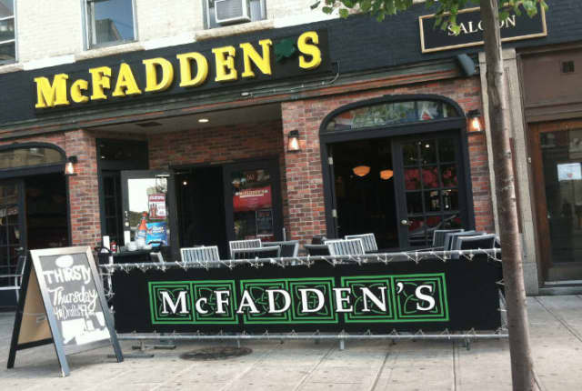 A bouncer was punched in the nose by a patron at McFadden's in downtown Stamford Wednesday night.