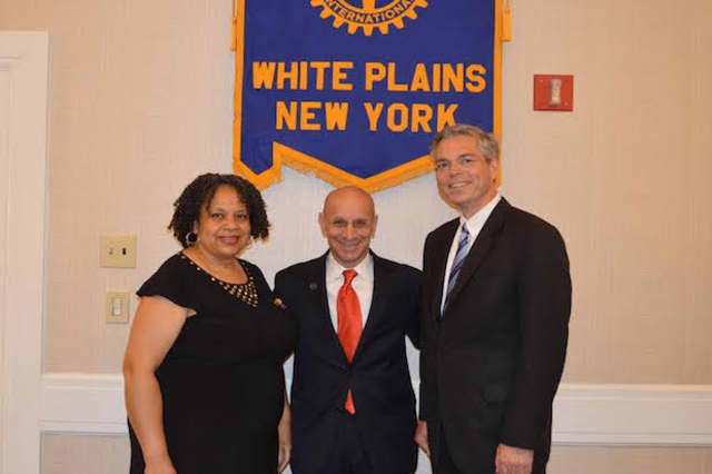 Heather Miller, left, the outgoing President, and White Plains Mayor Tom Roach, right, welcome L. William Fishman as the new president of the Rotary Club of White Plains.
