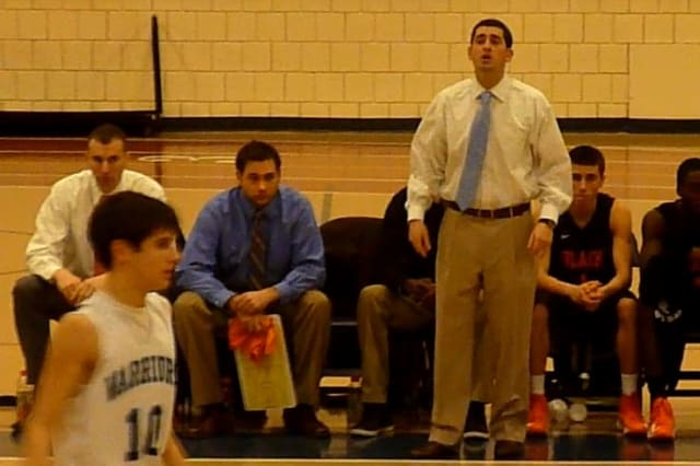 Stamford boys basketball coach Dan Melzer directs his team during Tuesday's game against Wilton.